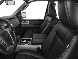 inside view of limo showing black front seats